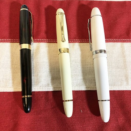 fountain pens red marble ivory white