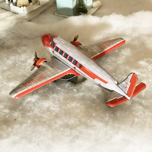 tin toy DC3 airplane