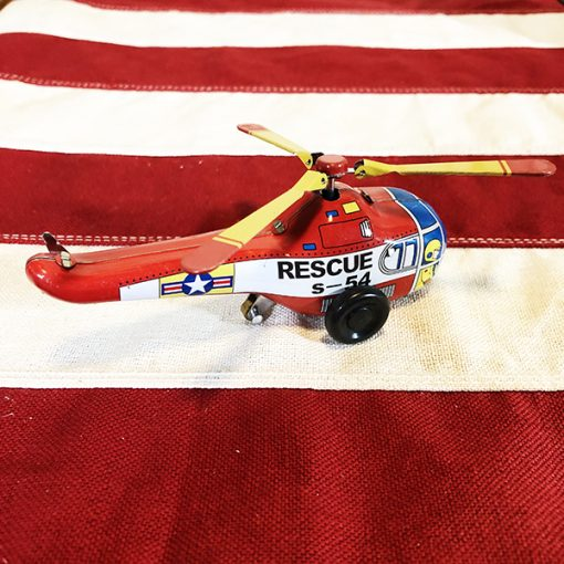 Helicopter tin toy side view